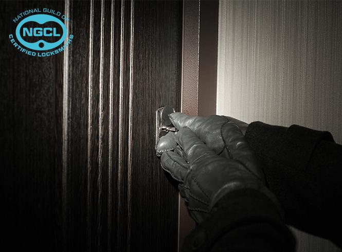 burglar putting key into lock