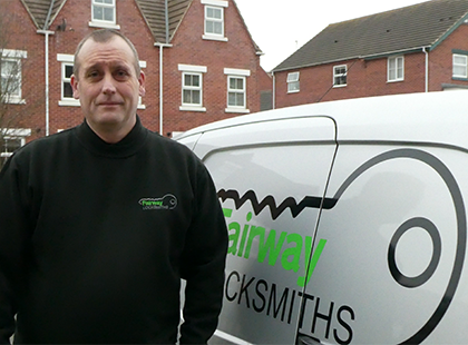 Brian the Locksmith stood in front of Van