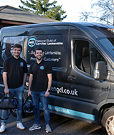 Two Locksmiths stood infront of the NGCL Locksmith van