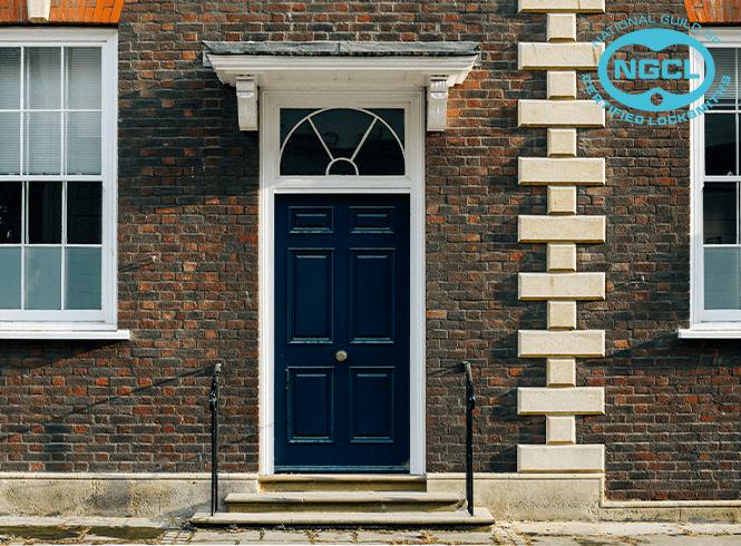 Blue front door on brick townhouse