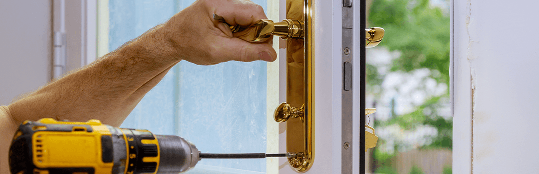 Locksmith Changing Door Lock and handle with power drill