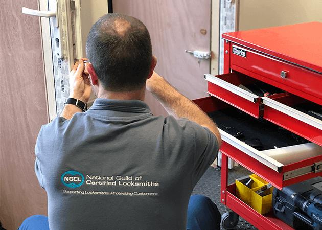 NGCL Locksmith working on door
